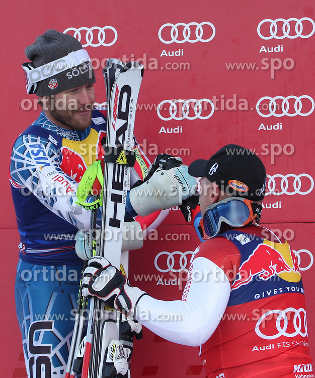 KITZBUHEL AUSTRIA. 22-01-2011. Bode Miller (USA) 2nd congratulates Didier Cuche (SUI) winner at the presentation ceremony for the 71st Hahnenkamm downhill race part of  Audi FIS World Cup races in Kitzbuhel Austria.  Mandatory credit: Mitchell Gunn