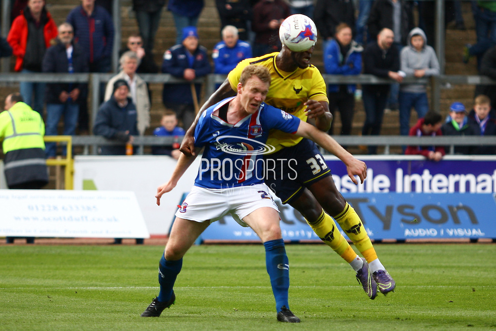 Oxford defender Cheyenne Dunkley challenges for the ball during the Sky Bet League 2 match between Carlisle United and Oxford United at Brunton Park, Carlisle, England on 30 April 2016. Photo by Craig McAllister.