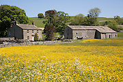Traditional stone farmhouse, Winterburn, Yorkshire Dales national park, England, UK