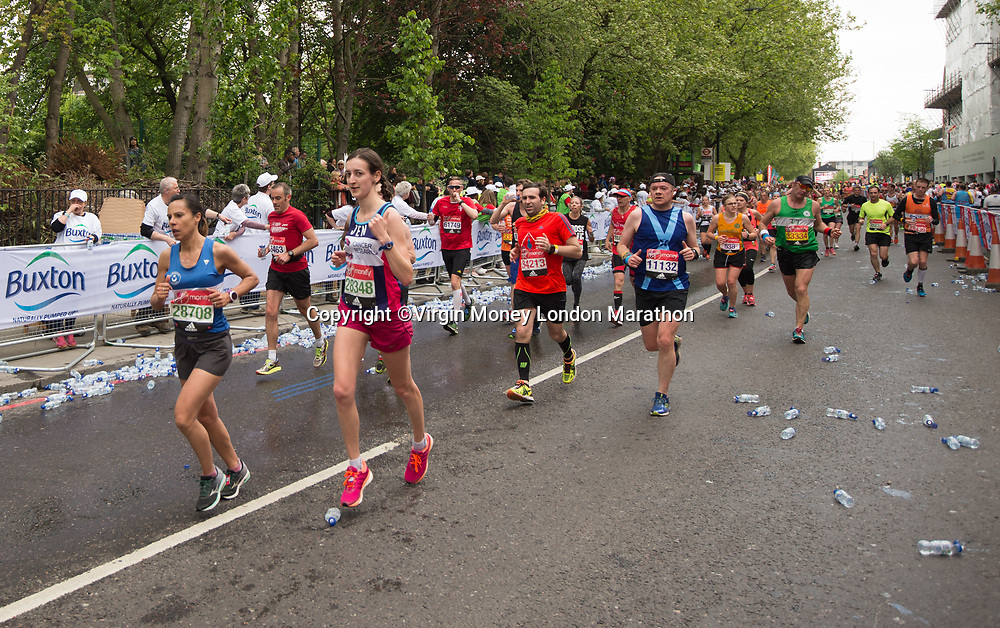 Runners at Mile 22 run past a Buxton water station during The Mass Event. The Virgin Money London Marathon, 23rd April 2017.<br /> <br /> Photo: Joe Toth for Virgin Money London Marathon<br /> <br /> For further information: media@londonmarathonevents.co.uk