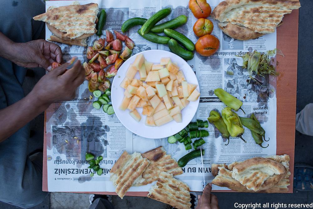 Melon seller's breakfast. Melon, roasted peppers, tomato, cucumber, pide. Diyarbakir, Turkey