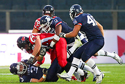 09.07.2011, UPC Arena, Graz, AUT, American Football WM 2011, Group B, France (FRA) vs Canada (CAN), im Bild Nick FitzGibbon (Canada, #34, RB) gets stopped by the french defense // during the American Football World Championship 2011 Group B game, France vs Canada, at UPC Arena, Graz, 2011-07-09, EXPA Pictures © 2011, PhotoCredit: EXPA/ T. Haumer