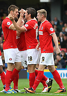 Picture by David Horn/Focus Images Ltd +44 7545 970036<br /> 14/09/2013<br /> Yann Kermorgant of Charlton Athletic (centre) celebrates scoring the opening goal with team mates during the Sky Bet Championship match at Vicarage Road, Watford.