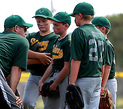 Coach Phil Clark talks with his team in quarterfinal game against Dan's Family Pizza. Subway LV lost the game.