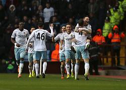 West Ham United's Kevin Nolan celebrates his first goal with West Ham United's Matthew Taylor - Photo mandatory by-line: Matt Bunn/JMP - Tel: Mobile: 07966 386802 08/02/2014 - SPORT - FOOTBALL - Birmingham - Villa Park - Aston Villa v West Ham United - Barclays Premier League