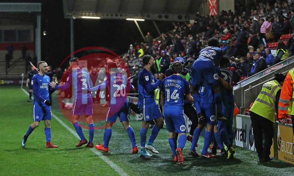 The Peterborough United players celebrate together after scoring the winning goal - Mandatory by-line: Joe Dent/JMP - 17/12/2017 - FOOTBALL - Highbury Stadium - Fleetwood, England - Fleetwood Town v Peterborough United - Sky Bet League One