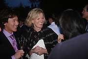Andy Wong and Lady Conran. Cartier dinner after thecharity preview of the Chelsea Flower show. Chelsea Physic Garden. 23 May 2005. ONE TIME USE ONLY - DO NOT ARCHIVE  © Copyright Photograph by Dafydd Jones 66 Stockwell Park Rd. London SW9 0DA Tel 020 7733 0108 www.dafjones.com
