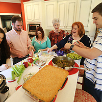 Sara-Catherine Trent, Jonathan Holt, Brittany Wilemon, Jane Hardin, Anelese Holt and Ty Trent work on preparing a meal in Jane Hardins kitchen.