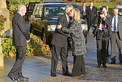 US Secretary of State Hillary Clinton gets a kiss from Northern Ireland First Minister Peter Robinson while the Deputy First Minister Martin McGuinness smiles upon her arrival at Stormont Castle, East Belfast, Northern Ireland, December 7, 2012. Photo by i-Images.