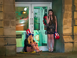 © Licensed to London News Pictures . 01/01/2018. Manchester, UK. Two women in a doorway opposite the Printworks . Revellers celebrate the start of the New Year in Manchester City Centre . Photo credit: Joel Goodman/LNP