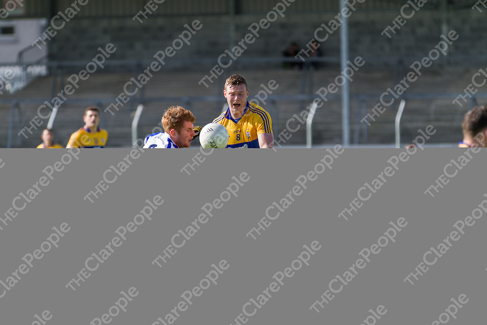 Clare's Darren O'Neill is tackled by Waterford's Ronan Cahill