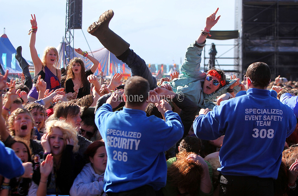 A music fan crowd surfs towards the safety stewards as You Me At Six perform live on the Main stage during the third and final day of Reading Festival on August 29, 2010 in Reading, England.  (Photo by Simone Joyner)
