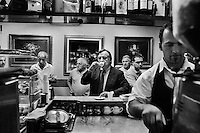 PALERMO, ITALY - 23 June, 2012: Mayor of Palermo Leoluca Orlando, 64, drinks an espresso coffee at Bar Ruvolo in the historic center of Palermo, Italy, on June 23, 2012. Leoluca Orlando, who became mayor of Palermo for the 4th time in May 2012 after taking part in the final round against Fabrizio Ferrandelli and won the runoff with 72% of the ### PALERMO, ITALIA - 23 giugno 2012: Il sindaco di Palermo Leoluca Orlando, 64 anni, beve un caffè espresso al Bar Ruvolo nel centro storico di Palermo il 23 giugno 2012. Leoluca Orlando, è diventato sindaco per la quarta nel maggio 2012 dopo aver partecpato al ballottaggio contro il suo delfino Fabrizio Ferrandelli e dopo aver vinto con il 72% dei voti.