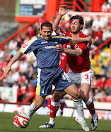 Coca Cola championship, Bristol City v Cardiff City at Ashton Gate ground in Bristol on Sun 15th March 2009. pic by Andrew Orchard, Andrew Orchard sports photography,  Cardiff city's Michael Chopra is tackled by Bristol's Jamie McAllister..