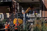 Roma 7 Maggio 2015<br /> Sgomberato questa mattina dalle forze dell'ordine lo spazio sociale occupato SCUP,le ruspe hanno abbattuto porte e finestre e reso inagibile  la palestra, la ludoteca, la biblioteca, e la scuola popolare di musica. L'edificio era occupato da tre anni. La ruspa abbatte il portone di SCUP<br /> Rome May 7, 2015<br /> Vacated  this morning by police,  the social  space occupied SCUP, the bulldozers have knocked down doors and windows and rendered unusable gym, game room, library, popular school of music. The building was occupied by three years. The bulldozer knocks down the door of SCUP.