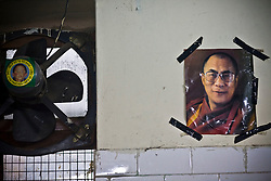 "INDIA - Life in Exile (Tibetan Refugees) <br /> A picture of Dalai Lama, right, and ""Free Panchen Lama"" campaign sticker are seen at reception center, a temporary shelter for newly arrived Tibetan refugees in McLeod Ganj, Dharamsala, India, where the Dalai Lama settled after fleeing Tibet in 1959 after a failed uprising against Chinese rule, May 29, 2009.  The 11th incarnation of the Panchen Lama, Gedhun Choekyi Nyima, was taken custody by Chinese authorities and vanished from public eyes shortly after being named by Dalai Lama in 1995."