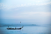 Fishermen set off to work at sunrise on their small traditional wooden boat near Cape Coast, roughly 120km west of Ghana's capital Accra on Thursday April 9, 2009..