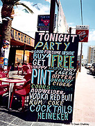 Signpost outside a bar advertising buy one get one free drinks Ibiza 1999