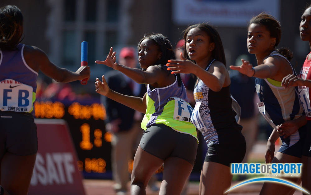 Apr 24, 2014; Philadelphia, PA, USA; Hollie Harris takes the handoff from Autumn Wright on the third leg on the Long Beach Poly girls 4 x 400m relay that won its heat in 3:45.20 in the 120th Penn Relays at Franklin Field.