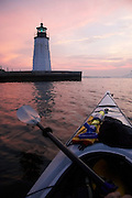USA, Newport, RI - First person perspective from kayak at Goat Island Light house
