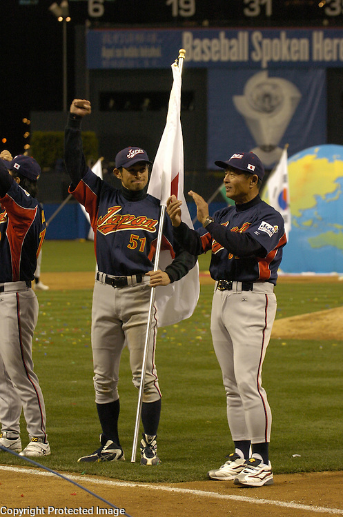 Team Japan's Ichiro Suzuki #51 raises his arms after beatig Team Cuba 10-6 in Final action of the World Baseball Classic at PETCO Park, San Diego, CA.