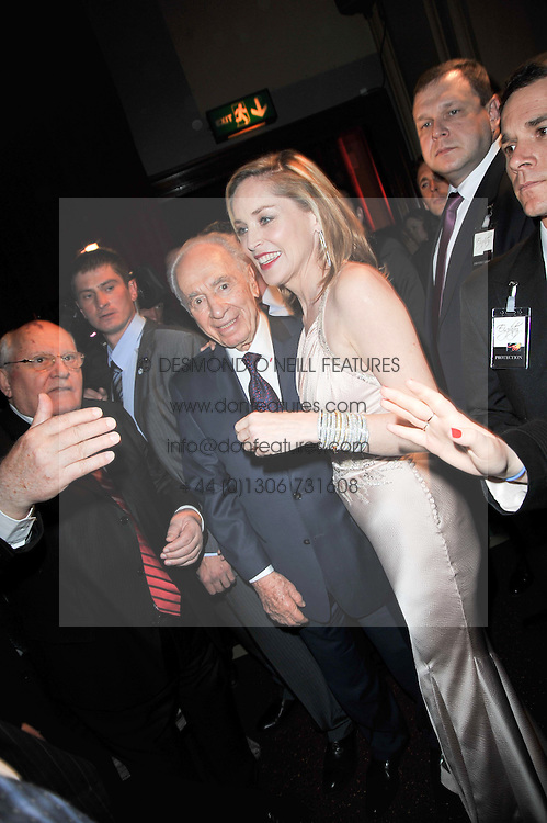 SHARON STONE and SHIMON PERES at a gala eveing to celebrate the 80th birthday of former Soviet leader Mikhail Gorbachev held at The Royal Albert Hall, London on 30th March 2011.