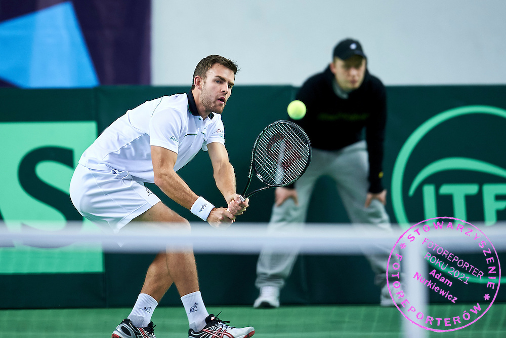 Laurynas Grigelis from Lithuania in action during first day the Davies Cup / Group I Europe / Africa 1st round tennis match between Poland and Lithuania at Orlen Arena on March 6, 2015 in Plock, Poland<br /> Poland, Plock, March 6, 2015<br /> <br /> Picture also available in RAW (NEF) or TIFF format on special request.<br /> <br /> For editorial use only. Any commercial or promotional use requires permission.<br /> <br /> Mandatory credit:<br /> Photo by &copy; Adam Nurkiewicz / Mediasport