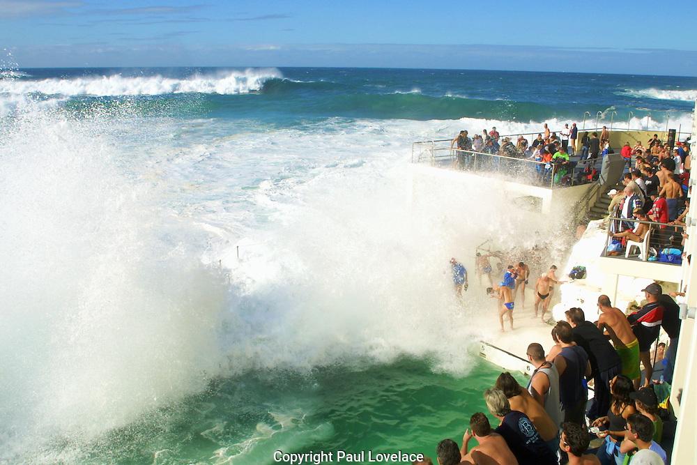 Massive surf conditions turn bondi icebergs white, during the traditional winter weekly swim, Sydney Australia.