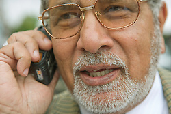 Older man using a mobile phone,