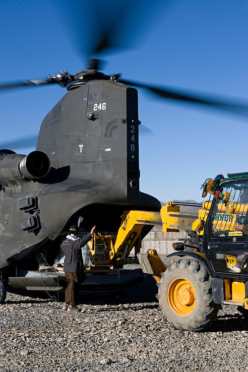 Pallets of food, fuel and clothing are loaded onto a CH-47 Chinook helicoper ready to deploy to the village of Rebat as part of a humanitarian assistance mission called Operation 'Winterstand'. FOB Bermel, Paktika Province, Afghanistan on the 18th of January 2008.