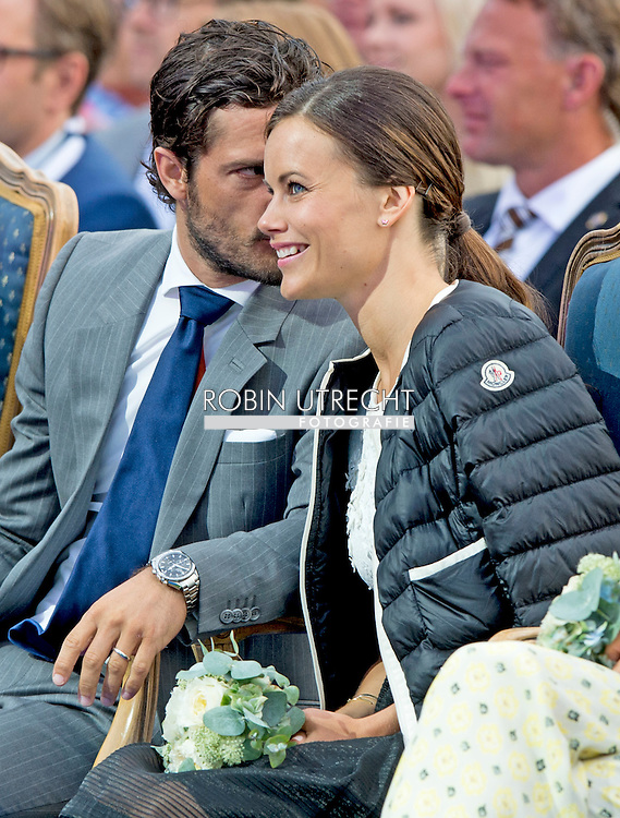 14-7-2015- Borgholm - King Carl-Gustav , queen Silvia , crown princess victoria , prince Daniel , prince Carl Philip , princess Sofia Hellqvist , princess Madeleine and Chris O'Neil at the victoriaday celebration at the stadium in Borgholm . COPYRIGHT ROBIN UTRECHT