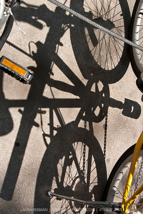 Bicycles and their sharply defined shadows.