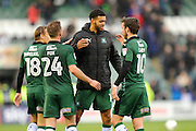 Jake Jervis (14) of Plymouth Argyle celebrates with Oscar Threlkeld (18) of Plymouth Argyle David Fox (24) of Plymouth Argyle and Graham Carey (10) of Plymouth Argyle at full time after Plymouth won 2-0 during the EFL Sky Bet League 2 match between Plymouth Argyle and Carlisle United at Home Park, Plymouth, England on 4 March 2017. Photo by Graham Hunt.