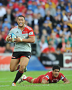 Robbie Fruean breaks through the tackle of Ben Tapuai ~ Super 15 rugby (Round 15) - Reds v Crusaders played at Suncorp Stadium, Brisbane, Australia on Sunday 29th May 2011 ~ Photo : Steven Hight (AURA Images) / Photosport