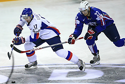 Lubomir Visnovsky of Slovakia and Marcel Rodman of Slovenia at ice-hockey game Slovenia vs Slovakia at second game in  Relegation  Round (group G) of IIHF WC 2008 in Halifax, on May 10, 2008 in Metro Center, Halifax, Nova Scotia, Canada. Slovakia won after penalty shots 4:3.  (Photo by Vid Ponikvar / Sportal Images)