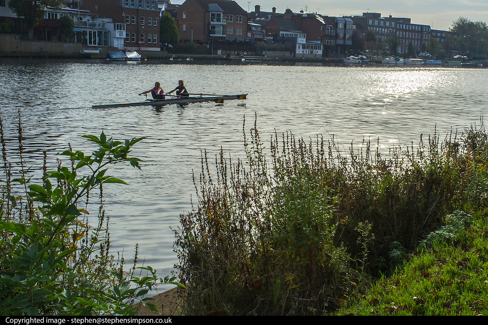 © Licensed to London News Pictures. 31/10/2014. Kingston Upon Thames, UK. Rowers in the morning sunshine. People enjoy the warm weather on the River Thames in Kingston Upon Thames today 31st October 2014. forecasters are predicting It could be the warmest halloween on record. Photo credit : Stephen Simpson/LNP