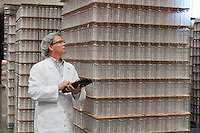 Man inspecting bottled water in distribution warehouse