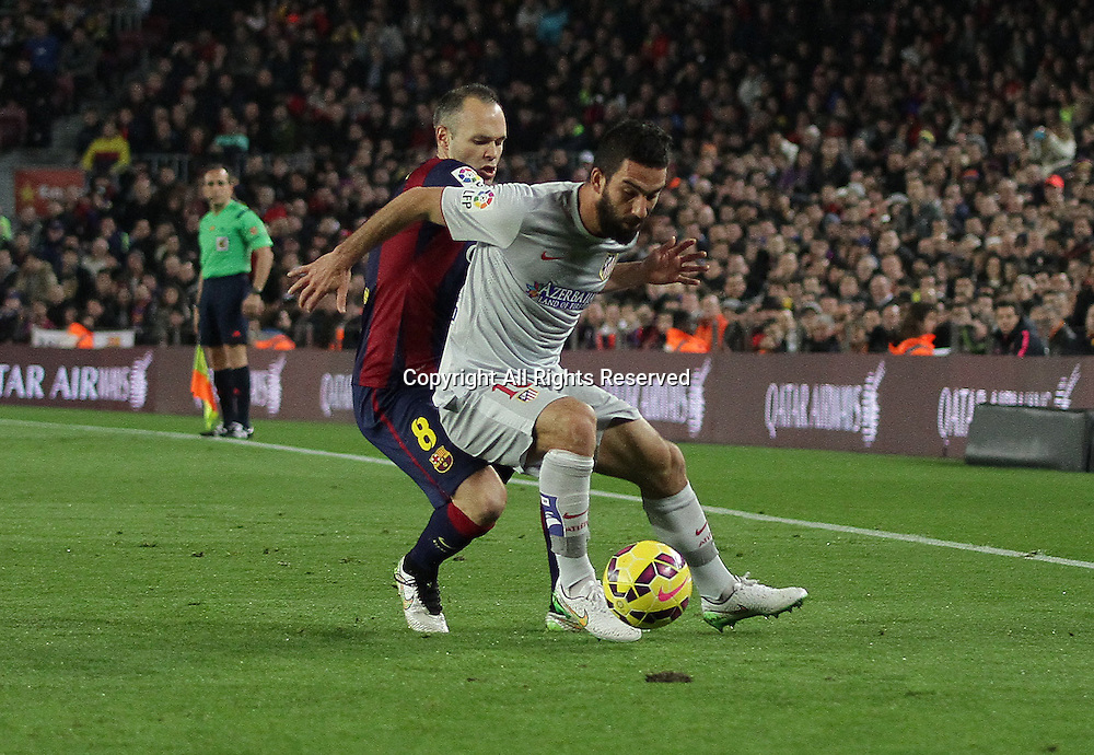 11.01.2015. Barcelona, Spain. La liga football. Barcelona versus Atletico Madrid. Arda challenged by Iniesta during the match
