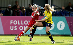 Charlie Estcourt of Bristol City Women crosses the ball past Rosie Lane of Oxford United - Mandatory by-line: Robbie Stephenson/JMP - 25/06/2016 - FOOTBALL - Stoke Gifford Stadium - Bristol, England - Bristol City Women v Oxford United Women - FA Women's Super League 2