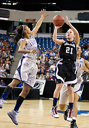 March 27, 2010; Sacramento, CA, USA; Gonzaga Bulldogs guard Courtney Vandersloot (21) shoot over Xavier Musketeers guard Special Jennings (1) during the first half in the semifinals of the Sacramental regional in the 2010 NCAA womens basketball tournament at ARCO Arena. Xavier defeated Gonzaga 74-56.
