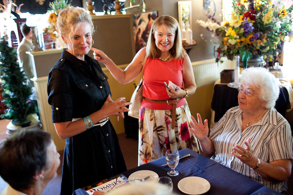 Political aide Susan Duprey (R) introduces Ann Romney, the wife of Mitt Romney, to New Hampshire voters at a campaign event at  Michele's Ristorante in Keene, NH on August 11, 2011.  (Matthew Cavanaugh for The Boston Globe)