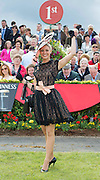 02/08/2012. Repro free first use.The winner of the Anthony Ryan's Best Dressed Lady Competition on Ladies Day at the Galway Races is 22 year old Kelli O' Dell , a student from New-South Wales Australia.  Ms O'Dell wore an ?Anaessia? Black lace dress, with champagne underlay, matching sash and butterfly broaches.  It was accessorized with black patent Tony Bianco Shoes and her grandmother's black gloves.  Photo:Andrew Downes..