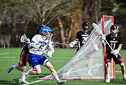 Lexington High School  senior Nate Sidel looks to take a shot on goal during the game against Winchester High School  in Lexington, April 24, 2018. Winchester won the game, 11-6.   [Wicked Local Photo/James Jesson]
