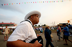 May 7th, 2006. New Orleans, Louisiana, USA. <br /> New Orleans Jazz and Heritage Festival. The first JazzFest after Hurricane Katrina.<br /> Legendary jazz musician Ellis Marsalis wanders the crowds in search of food before the end of the day.  <br /> Ellis Marsalis passed away April 1st 2020 of complications associated with Coronavirus - COVID-19.<br /> Photo ©; Charlie Varley/varleypix.com