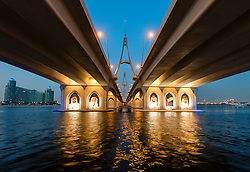Evening view from below of Business Bay Bridge in Dubai United Arab Emirates