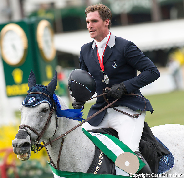 QUENTIN JUDGE (USA) rides HH DARK DE LA HART in the victory lap after placing 2nd in the 1.50m Derby Nexen Cup during National CSI 5* at Spruce Meadows presented by Rolex, June 7 2015. Calgary.