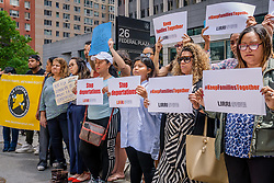June 15, 2018 - New York, New York, United States - At the start of father's day weekend, families of fathers facing deportation, community organizations, and allies, gathered outside Immigration Court at 26 Federal Plaza on June 15, 2018, to raise their voices calling for an end to deportations. Several pairs of shoes were laid on the sidewalk to symbolize the fathers separated from their families. (Credit Image: © Erik Mcgregor/Pacific Press via ZUMA Wire)