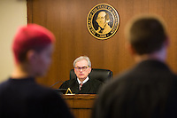 Spokane Superior Court Judge Gregory Sypolt explains the legal finacial obligations to a defendant during a hearing Wednesday, July 22, 2015 in Spokane, Wash.