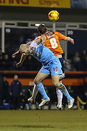 Andy Drury of Luton Town (right) and Russell Penn of York City (left) in an aerial battle during the Sky Bet League 2 match at Kenilworth Road, Luton<br /> Picture by David Horn/Focus Images Ltd +44 7545 970036<br /> 10/02/2015
