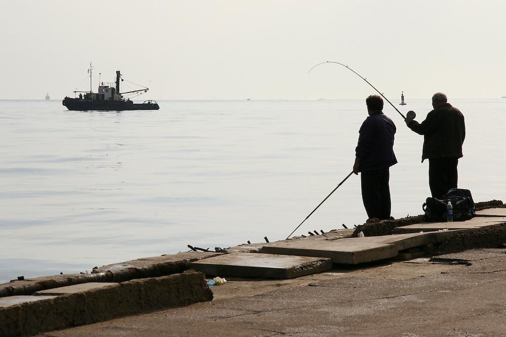 Men fish in the Caspian Sea on October 30, 2005 in Baku, Azerbaijan.